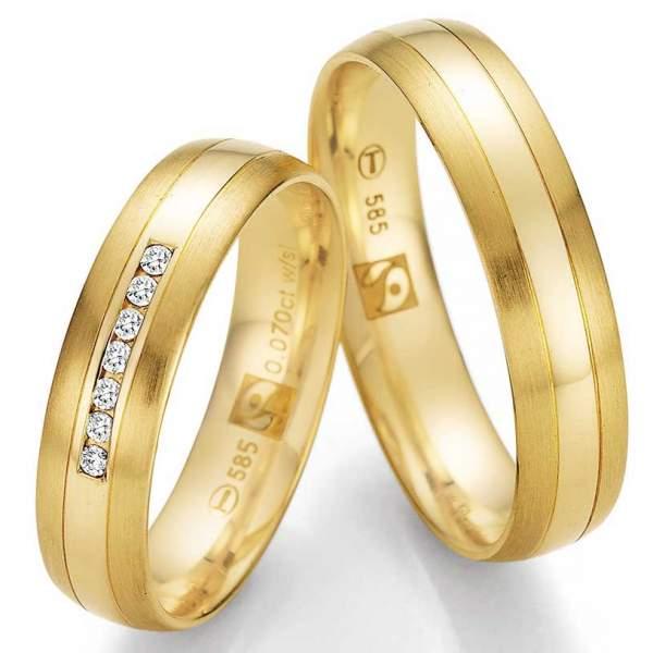 Wunderschöne Eheringe aus Fairtrade Gelbgold mit 7 Diamanten