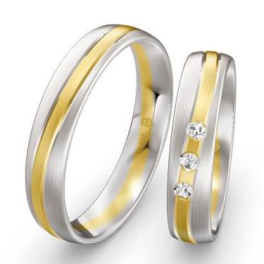 Eheringe-Weissgold-Gelbgold-mit-mehreren-Diamanten