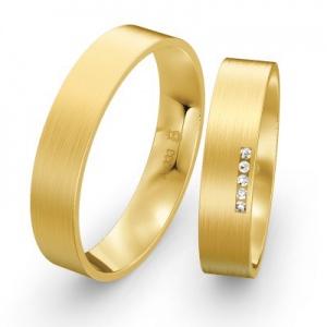 Goldene Partnerringe mit Steinbesatz